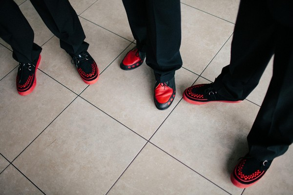 Groom and groomsmen with red fifty's rockabilly shoes.