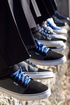 Groom and groomsmen with vans shoes and blue laces.