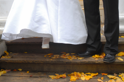 Bride and grooms feet walking down stairs.