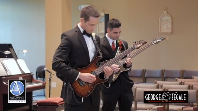 Groom and groomsmen playing guitar during wedding entrance.