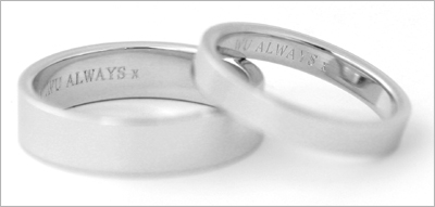 Engraved bride and groom wedding bands.