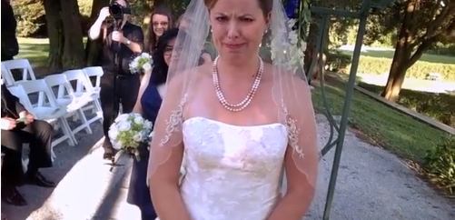 View of bride, during the ceremony, from pov of groom hidden camera.