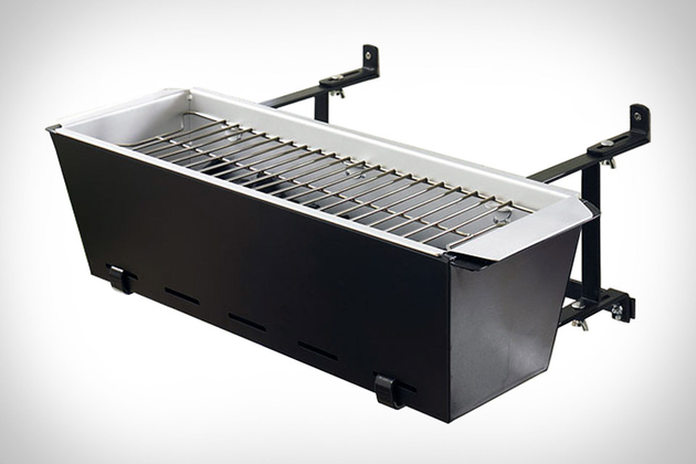 A BBQ grill that hangs on a balcony like a flowerpot.