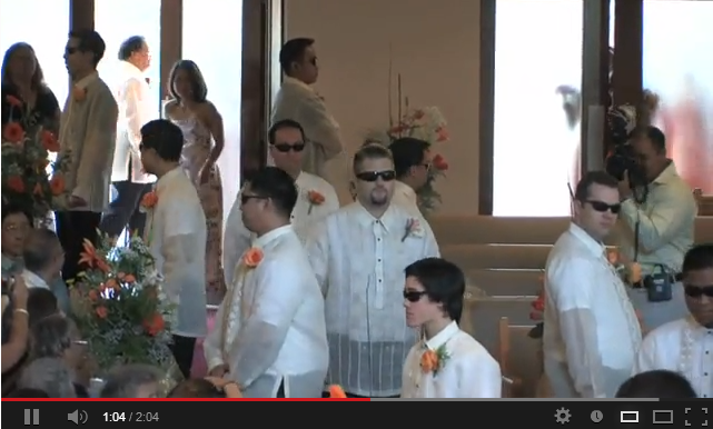 Image of groom and groomsmen at the ceremony.