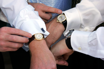 Arms of guys checking their watch.