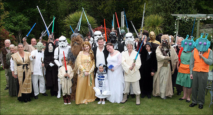 Wedding family photo with everyone dressed as a Star Wars character.