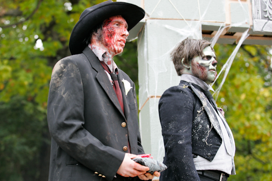 Zombie groom and best man during wedding ceremony.